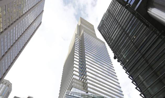 """The Bloomberg LP Tower, which houses Bloomberg News, is shown Monday, May 13, 2013, in New York.  Bloomberg LP, a financial data and news company, said it has corrected a """"mistake"""" in its news gathering policies and cut off its journalists' special access to client log-in activity on the company's ubiquitous trading information terminals after  Goldman Sachs complained about the matter last month. (AP Photo/Kathy Willens)"""