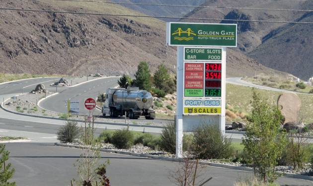 "A tanker passes the Golden Gate Auto Truck Plaza at the Tahoe Reno Industrial Center bound for U.S. Interstate 80, Thursday, Sept. 4, 2014, 15 miles east of Sparks, Nev., near the access road to the site where Tesla Motors Inc. plans to build a 6,500 worker ""gigafactory"" to mass produce cheaper lithium batteries for its next line of more-affordable electric cars. (AP Photo/Scott Sonner)"
