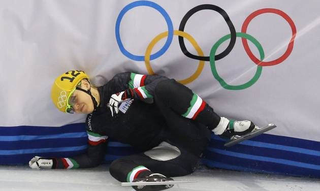 Arianna Fontana of Italy crashes out in a women's 1000m short track speedskating quarterfinal at the Iceberg Skating Palace during the 2014 Winter Olympics, Friday, Feb. 21, 2014, in Sochi, Russia. (AP Photo/Vadim Ghirda)