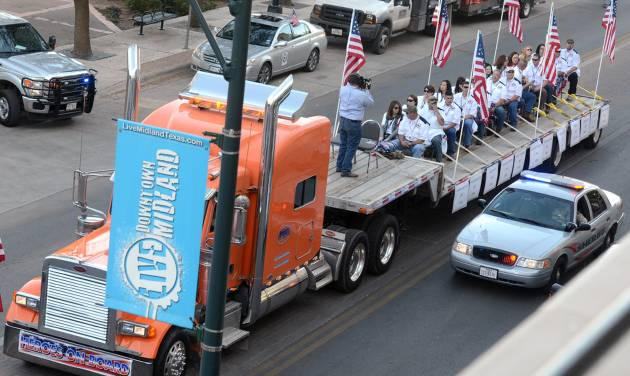 "A flatbed truck carries wounded veterans and their families during a parade before it was struck by a train Thursday, Nov. 15, 2012 in Midland, Texas. ""Show of Support"" president and founder Terry Johnson says there are ""multiple injuries"" after a Union Pacific train slammed into the trailer, killing at least four people and injuring 17 others. (AP Photo/Reporter-Telegram, James Durbin)"
