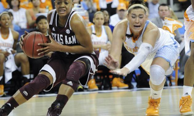 Texas A&M guard Courtney Walker (33) gets by a diving Tennessee guard Taber Spani (13) during the first half of a NCAA college basketball game in the Southeastern Conference tournament, Saturday, March 9, 2013, in Duluth, Ga. (AP Photo/John Amis) ORG XMIT: GAJA101