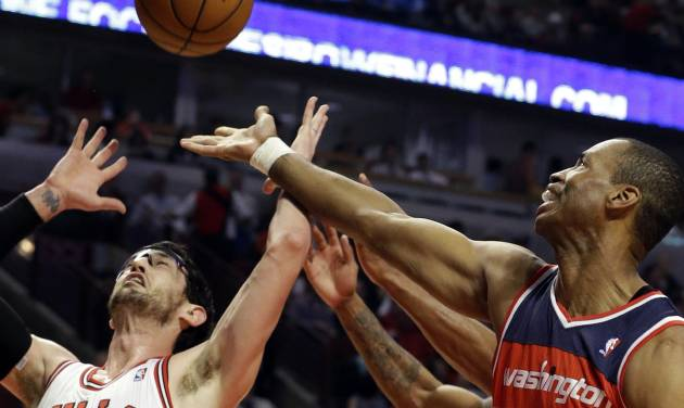 FILE - In a Wednesday, April 17, 2013 file photo, Washington Wizards center Jason Collins, right, battles for a rebound against Chicago Bulls guard Kirk Hinrich during the first half of an NBA basketball game in Chicago. NBA veteran center Collins has become the first male professional athlete in the major four American sports leagues to come out as gay. Collins wrote a first-person account posted Monday, April 29, 2013 on Sports Illustrated's website. (AP Photo/Nam Y. Huh, File)