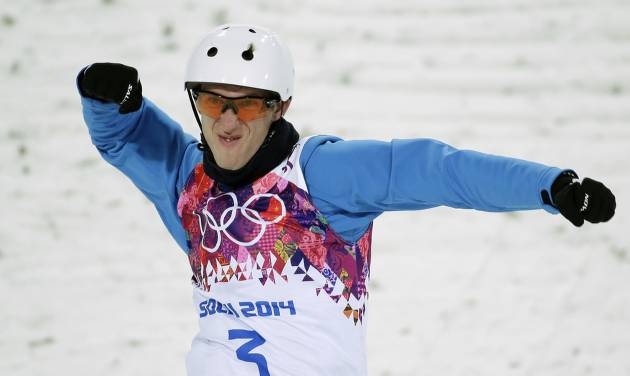 Gold medal winner Anton Kushnir of Belarus celebrates after his final jump during the men's freestyle skiing aerials at the Rosa Khutor Extreme Park, at the 2014 Winter Olympics, Monday, Feb. 17, 2014, in Krasnaya Polyana, Russia. (AP Photo/Charlie Riedel)