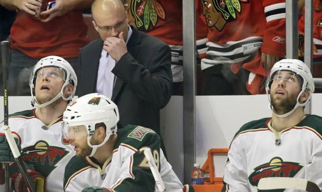 Minnesota Wild head coach Mike Yeo reacts as he watches his team during the second period of Game 5 of an NHL hockey Stanley Cup first-round playoff series against the Chicago Blackhawks in Chicago, Thursday, May 9, 2013. (AP Photo/Nam Y. Huh)