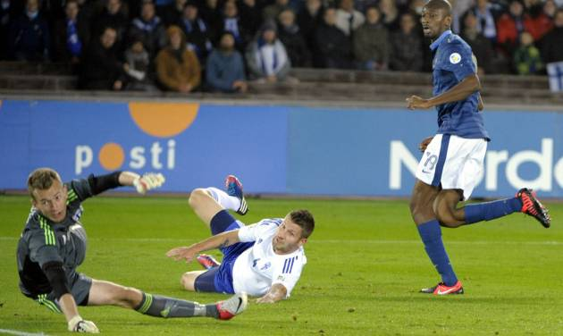 France's Abou Diaby (R) scores the first goal past Finland's goalie Lukas Hradecky (L) and defender Joona Toivio during first half of the FIFA World Cup 2014 qualification match Finland vs France in Helsinki on Friday, Sept 7 2012. (AP Photo/Jussi Nukari, Lehtikuva) FINLAND OUT