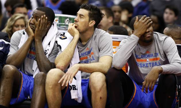 From left to right, Oklahoma City Thunder center Kendrick Perkins forward Nick Collison and forward Kevin Durant sit on the bench, in the second half of an NBA basketball game against the Washington Wizards, Saturday, Feb. 1, 2014, in Washington. The Wizards won 96-81. (AP Photo/Alex Brandon)