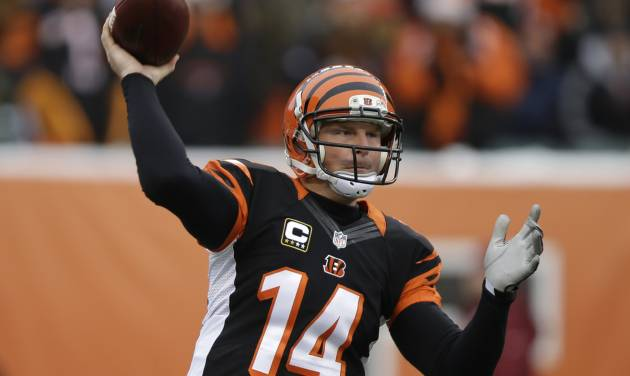 Cincinnati Bengals quarterback Andy Dalton passes against the Indianapolis Colts in the first half of an NFL football game, Sunday, Dec. 8, 2013, in Cincinnati.  Cincinnati won 42-28. (AP Photo/Al Behrman)