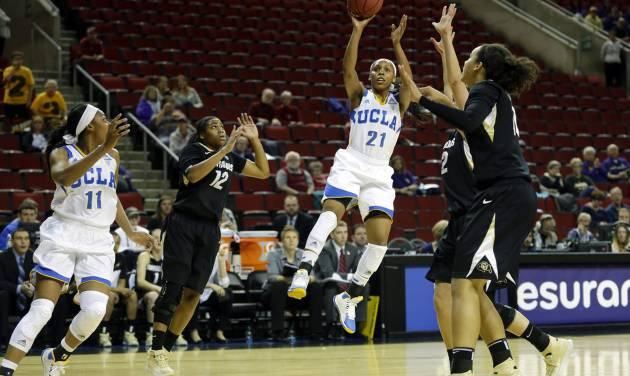 UCLA guard Nirra Fields (21) puts up a shot as UCLA's Atonye Nyingifa, left, and Colorado guard Ashley Wilson, second from left, stand near in the first half of an NCAA college basketball game in the Pac-12 women's tournament, Thursday, March 6, 2014, in Seattle. (AP Photo/Ted S. Warren)