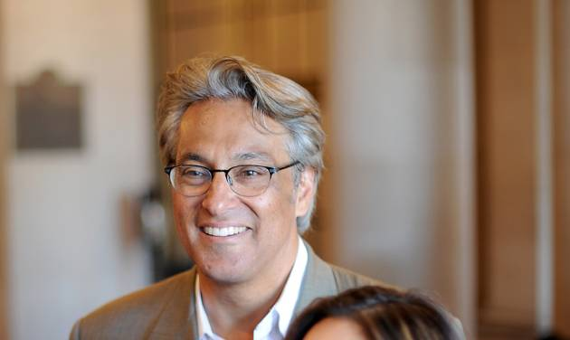 Suspended San Francisco Sheriff Ross Mirkarimi and his wife Eliana Lopez arrive at a Board of Supervisors meeting on Tuesday, Oct. 9, 2012, in San Francisco. The Board planned to vote on removing Mirkarimi, who pled guilty to a misdemeanor charge in a domestic violence case, from office. (AP Photo/Noah Berger)