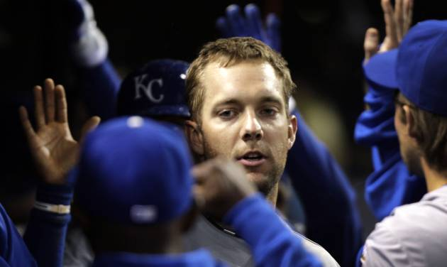 Kansas City Royals left fielder Alex Gordon celebrates in the dugout after hitting a three-run home run against the Cleveland Indians in the ninth inning of a baseball game in Cleveland, Wednesday, April 25, 2012. (AP Photo/Amy Sancetta)