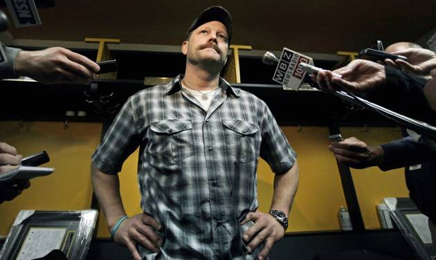 Boston Bruins goalie Tim Thomas pauses to speak to reporters in the locker room at TD Garden in Boston, Friday, April 27, 2012, about their loss to the Washington Capitals in Game 7 and the Bruins' elimination from the Stanley Cup hockey playoffs. (AP Photo/Elise Amendola)