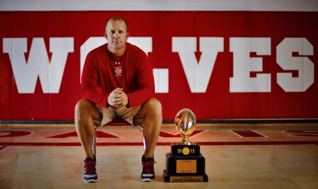 Davis football coach Jody Weber poses for a photo with the Class 2A championship trophy at the school in Davis, Okla. on Wednesday, Aug. 6, 2014. Photo by Chris Landsberger, The Oklahoman  CHRIS LANDSBERGER