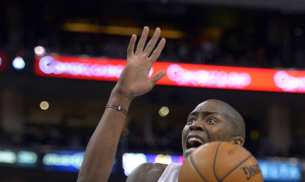 Los Angeles Clippers guard Jamal Crawford, right, goes up for a shot as Utah Jazz guard Alec Burks defends during the second half of their NBA basketball game, Sunday, Dec. 30, 2012, in Los Angeles. The Clippers have 107-96. (AP Photo/Mark J. Terrill)
