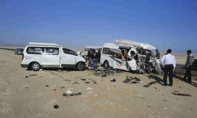 The aftermath of a two-vehicle accident, which left at least four Germans and several Egyptians dead and others injured, is seen on the road between Hurghada and Safaga on the Red Sea coast of Egypt, Sunday, Dec. 2, 2012. Egypt's roads are among the most dangerous in the world. Car accidents are common due to lax enforcement of driving laws and poorly paved roads, leading to thousands of deaths each year. (AP Photo)