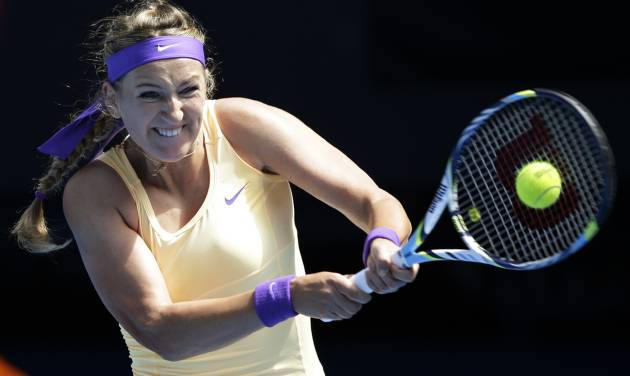 Victoria Azarenka of Belarus serves to Jamie Hampton of the US during their third round match at the Australian Open tennis championship in Melbourne, Australia, Saturday, Jan. 19, 2013. (AP Photo/Andy Wong)