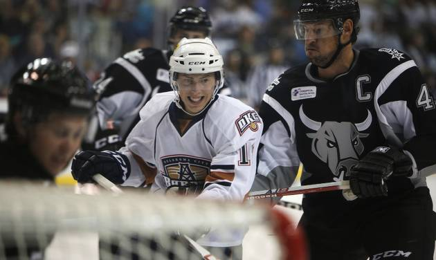 AHL HOCKEY: Oklahoma City's Ryan Nugent-Hopkins (18) struggles with San Antonio players during a game between the Oklahoma City Barons and the San Antonio Rampage at the Cox Convention Center in Oklahoma City, Friday, Oct. 19, 2012.  Photo by Garett Fisbeck, The Oklahoman