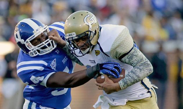 Georgia Tech quarterback Tevin Washington, right, runs the ball against the defense of Duke's C.J. France in the first quarter of an NCAA college football game on Saturday, Nov. 17, 2012, in Atlanta. (AP Photo/David Goldman)