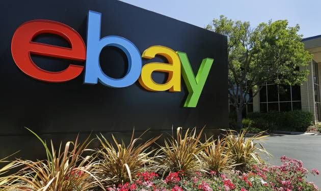 This Tuesday, July 16, 2013 photo shows an eBay sign at eBay headquarters in San Jose, Calif. Ebay Inc. reports earnings after the U.S. stock market closes on Wednesday, Jan. 22, 2014. (AP Photo/Ben Margot)