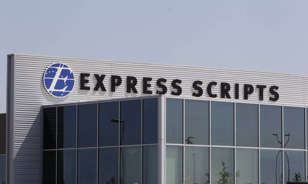 FILE - This July 21, 2011, file photo shows a building on the Express Scripts campus in Berkeley, Mo. Express Scripts Holding Co. reports quarterly earnings on Tuesday, April 29, 2014. (AP Photo/Jeff Roberson, File)