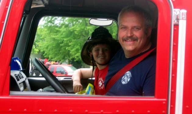 This image provided by Gallitan County Fire Department shows Chief Todd Rummel, who was killed in an accident June 19, 2014, after a fire engine and a pickup truck collided on a Montana highway, causing an explosion and fire that killed a family of five and Rummel. Passenger is unidentified. (AP Photo/Gallitan County Fire Department)
