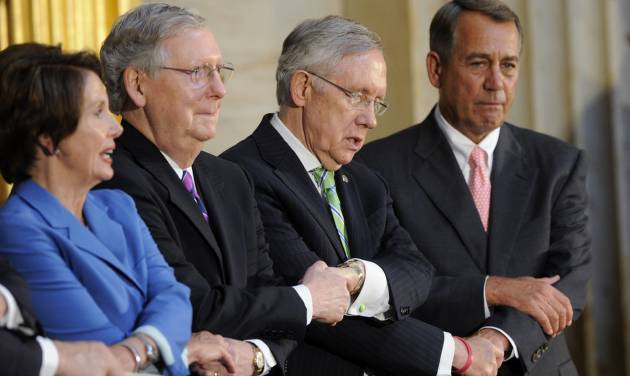 """From left, House Minority Leader Nancy Pelosi of Calif., Senate Minority Leaders Mitch McConnell of Ky., Senate Majority Leader Harry Reid of Nev. and House Speaker John Boehner of Ohio hold hands as they sing, """"We Shall Overcome,"""" during a 50th anniversary of the Civil Rights Act of 1964 ceremony, Tuesday, June 24, 2014, in the Capitol Rotunda on Capitol Hill in Washington. A Congressional Gold Medal in honor of the Reverend Doctor and Mrs. Martin Luther King, Jr., who were instrumental in the law's passage, was also presented. (AP Photo/Susan Walsh)"""