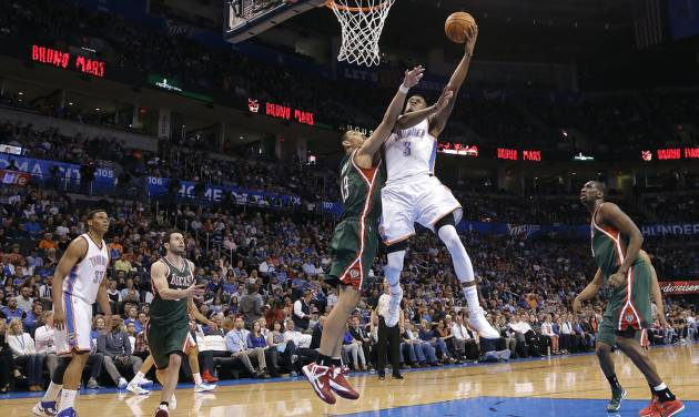 Oklahoma City's Perry Jones (3) shoots over Milwaukee's Gustavo Ayon (19) during the season finale NBA basketball game between the Oklahoma City Thunder and the Milwaukee Bucks at Chesapeake Energy Arena on Wednesday, April 17, 2013, in Oklahoma City, Okla.   Photo by Chris Landsberger, The Oklahoman