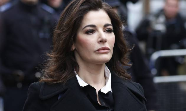 FILE - In this Wednesday, Dec. 4, 2013 file photo, British chef Nigella Lawson arrives at Isleworth Crown Court in London. The U.S. Embassy in London said on Thursday, April 3, 2014 that Lawson was denied permission to board a flight to the United States on the weekend. The embassy did not disclose the reason for refusing Lawson. (AP Photo/Sang Tan, File)