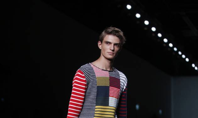 A models wears a creation for Fendi men's Spring-Summer 2015 collection, part of the Milan Fashion Week, unveiled in Milan, Italy, Monday, June 23, 2014. (AP Photo/Luca Bruno)
