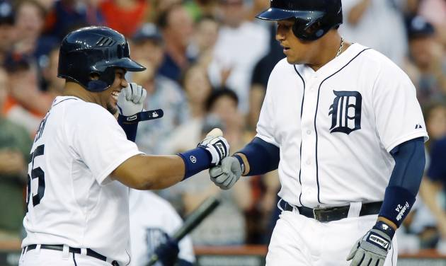 Detroit Tigers Miguel Cabrera, right, is welcomed at home plate by teammate Brayan Pena after hitting a three-run home run against the Boston Red Sox in the fifth inning of a baseball game on Friday, June 21, 2013, in Detroit. (AP Photo/Duane Burleson)