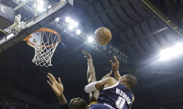 Oklahoma City Thunder's Russell Westbrook (0) shoots over Indiana Pacers' Roy Hibbert during the first half of an NBA basketball game on Friday, April 5, 2013, in Indianapolis. (AP Photo/Darron Cummings)