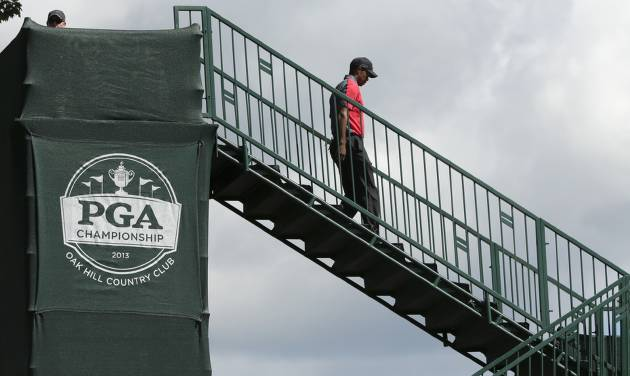 Tiger Woods walks to the first tee during the final round of the PGA Championship golf tournament at Oak Hill Country Club, Sunday, Aug. 11, 2013, in Pittsford, N.Y. (AP Photo/Charlie Riedel)
