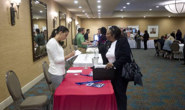 In this Friday, Nov. 30, 2012 photo, a person fills out an application at the Fort Lauderdale Career Fair, in Dania Beach, Fla. The U.S. economy added a solid 146,000 jobs in November and the unemployment rate fell to 7.7 percent, the lowest since December 2008, the Labor Department announced Friday, Dec. 7, 2012. The government said Superstorm Sandy had only a minimal effect on the figures. (AP Photo/J Pat Carter)