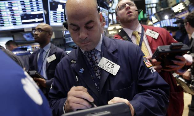 Trader Fred DeMarco, center, works on the floor of the New York Stock Exchange Thursday, May 2, 2013. Stocks are opening higher on Wall Street, a day after the market's biggest fall in two weeks, after General Motors and other big companies announced higher profits. (AP Photo/Richard Drew)