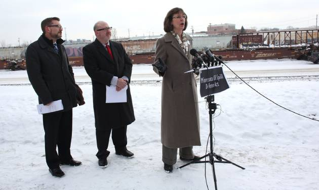 Kathy Hollander addresses the media about her concerns about the state's ability to react to an oil spill or explosion during a press conference near a rail way in St. Paul, Minn., Wednesday, Feb. 12, 2014. Recent crude oil train catastrophes in North Dakota and Canada show that Minnesota needs to beef up its ability to protect its communities from similar disasters. Looking on are state Rep. Frank Hornstien, center, and state Sen. Scott Dibble, left, who outlined a bill they plan to introduce at the start of the upcoming legislative session. (AP Photo/The Star Tribune, Kyndell Harkness) MANDATORY CREDIT; ST. PAUL PIONEER PRESS OUT; MAGS OUT; TWIN CITIES TV OUT