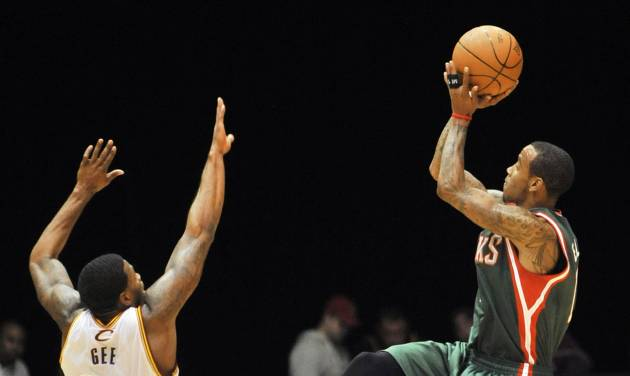 Milwaukee Bucks guard Monta Ellis, right, shoots over Cleveland Cavaliers guard Alonzo Gee during the first quarter of a preseason NBA basketball game, Tuesday, Oct. 9, 2012, in Canton, Ohio. (AP Photo/David Richard)