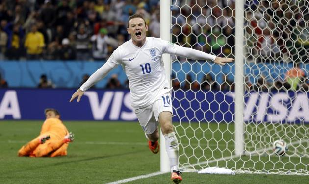 England's Wayne Rooney celebrates after scoring his side's first goal during the group D World Cup soccer match between Uruguay and England at the Itaquerao Stadium in Sao Paulo, Brazil, Thursday, June 19, 2014.  (AP Photo/Kirsty Wigglesworth)