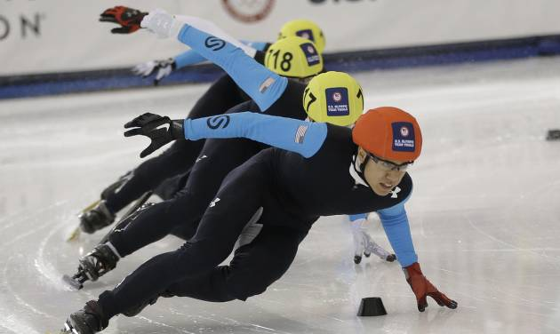 J.R. Celski, right, leads the pack as he competes in the men's 500 meters during the U.S. Olympic U.S. short track speedskating trials Saturday, Jan. 4, 2014, in Kearns, Utah. (AP Photo/Rick Bowmer)