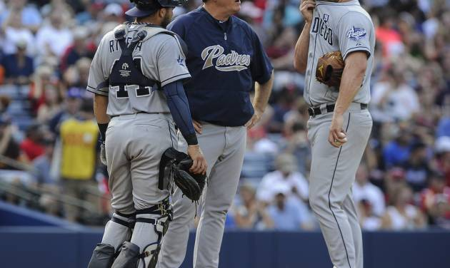 San Diego Padres pitcher Eric Stults, right, is visited at the mound by pitching coach Darren Balsley, and catcher Rene Rivera, left, after allowing a score and two men on base by the Atlanta Braves during the third inning of a baseball game, Sunday, July 27, 2014, in Atlanta. (AP Photo/John Amis)