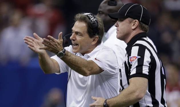 Alabama coach Nick Saban makes a point to an official during the first half of the Sugar Bowl NCAA college football game against Oklahoma, Thursday, Jan. 2, 2014, in New Orleans. (AP Photo/Patrick Semansky)