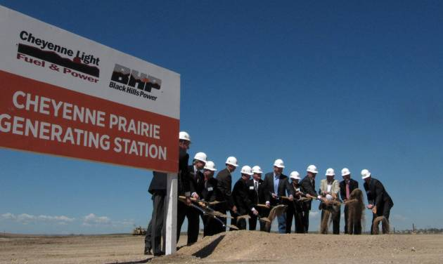 Local and Wyoming state leaders take part in a  ground-breaking ceremony for a $237 million gas-fired power plant being built by Black Hills Corp. and two subsidiaries, Wednesday, May 22, 2013 on the outskirts of Cheyenne,  Wyo. The 132-megawatt plant will employ up to 12 people after it is completed next year. (AP Photo/Mead Gruver)