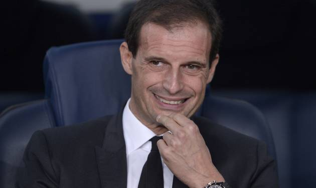 FILE - In this file photo taken in Barcelona on Nov. 6, 2013, AC Milan former coach Massimiliano Allegri waits for the start of the Champions League match between FC Barcelona and AC Milan. Massimiliano Allegri has been hired to coach Italian champion Juventus a day after Antonio Conte unexpectedly left the club. The 46-year-old Allegri was fired by Milan in January after 3 1/2 seasons with the squad, having led the Rossoneri to the Serie A title in his first year in charge in 2010-11.The 46-year-old Allegri was fired by Milan in January after 3 1/2 seasons with the squad, having led the Rossoneri to the Serie A title in his first year in charge in 2010-11. (AP Photo/Manu Fernandez)