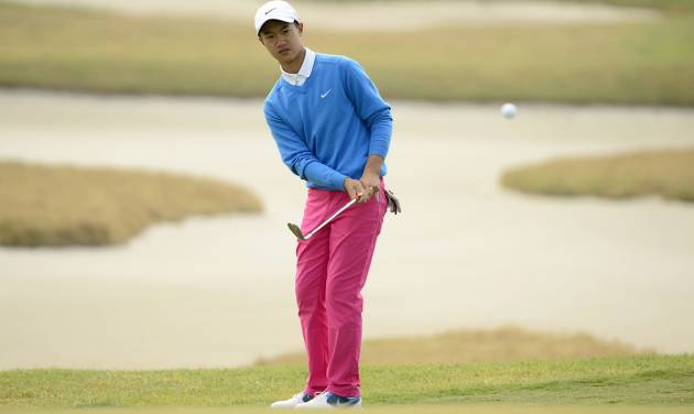 In this photo released by OneAsia, 12-year-old Chinese amateur Ye Wocheng watches his shot during the second round of China Open golf tournament at Tianjin Binhai Lake Golf Club in Tianjin, China on Friday, May 3, 2013. Ye has become the youngest player ever to compete in a European Tour event. (AP Photo/OneAsia, Paul Lakatos) NO LICENSING