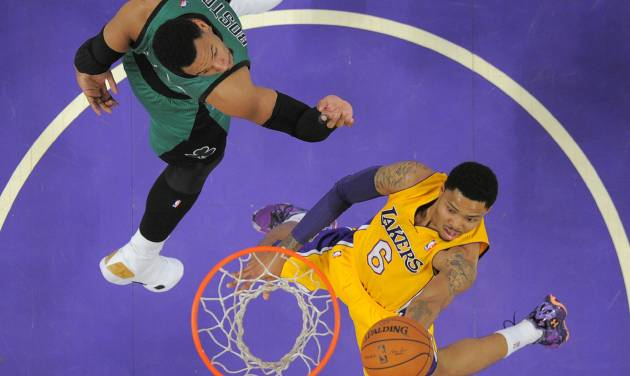 Los Angeles Lakers guard Kent Bazemore, right, goes up for a shot as Boston Celtics center Jared Sullinger defends during the first half of an NBA basketball game, Friday, Feb. 21, 2014, in Los Angeles. (AP Photo/Mark J. Terrill)
