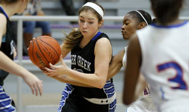 Deer Creek's Whitney Jones, left, goes past Millwood's Deztinee Gooden during their high school basketball game in the Bethany Classic tournament in Bethany, Okla., Friday, Jan. 10, 2014. Photo by Bryan Terry, The Oklahoman