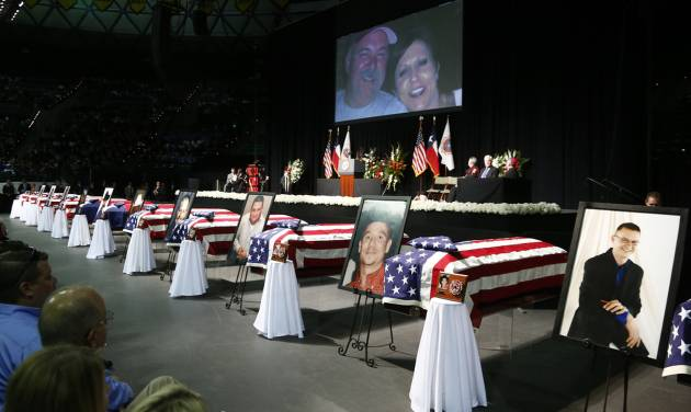 Casket sit in front of the stage of a memorial for firefighters who were killed in the West, Texas, fertilizer plant explosion prior to President Barack Obama's arrival, Thursday, April 25, 2013, at Baylor University in Waco,Texas. (AP Photo/Charles Dharapak)