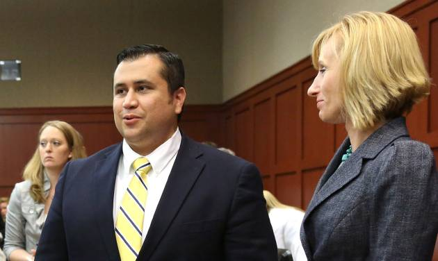 George Zimmerman, left, smiles while standing next to defense counsel Lorna Truettwhile, waiting for the jury to leave the courtroom during the 15th day of his trial in Seminole circuit court, in Sanford, Fla., Friday, June 28, 2013.  Zimmerman is charged with second-degree murder for the 2012 shooting death of Trayvon Martin. (AP Photo/Orlando Sentinel, Joe Burbank, Pool)