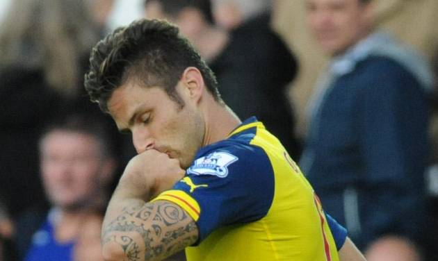 Arsenal's Olivier Giroud kisses his hand after scoring against Everton during the English Premier League soccer match between Everton and Arsenal at Goodison Park, in Liverpool, England, Saturday, Aug. 23, 2014. (AP Photo/Rui Vieira)