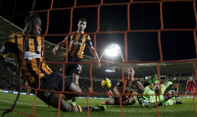 Hull City's goalkeeper Steve Harper, bottom right, dives in vain as Southampton's Jose Fonte, out of frame, scores during their English Premier League soccer match at the KC Stadium, Hull, England, Tuesday Feb. 11, 2014. (AP Photo/Jon Super)