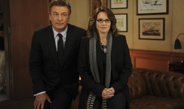 """In this 2011 image released by NBC, Alec Baldwin portrays Jack Donaghy, left, and Tina Fey portrays Liz Lemon in the NBC comedy series, """"30 Rock."""" The series will broadcast live on Thursday, April 26, 2012. (AP Photo/NBC, Ali Goldstein)"""