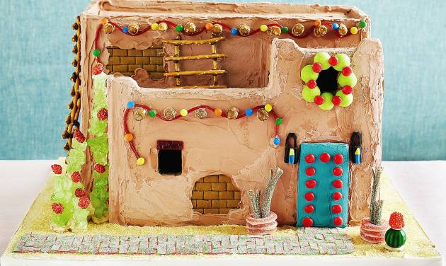 """This pueblo gingerbread house from """"The Gingerbread Architect"""" features green rock candy, cacti with burnt peanut blooms, pretzel stick ladders, adobe colored icing and """"bricks"""" etched into the unbaked gingerbread. Photo by Alexandra Grablewski"""